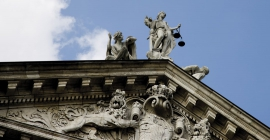 Statue of Justice on top of building
