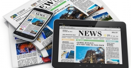 newspapers and e-readers with headlines